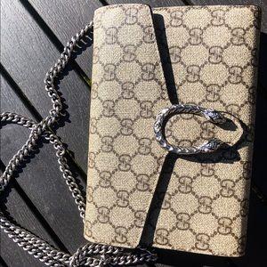 Cross body or clutch Gucci bag. Red inside